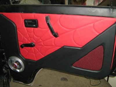 Black and red spider web door upholstery
